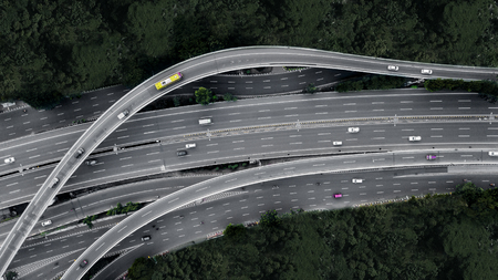 Foto de Aerial view of cars crossing interchange overpass in the downtown Jakarta, Indonesia - Imagen libre de derechos