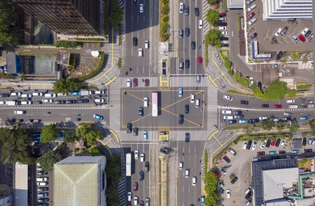 Photo pour JAKARTA - Indonesia. Top view of vehicle on crossroads with crosswalk in Jakarta city - image libre de droit
