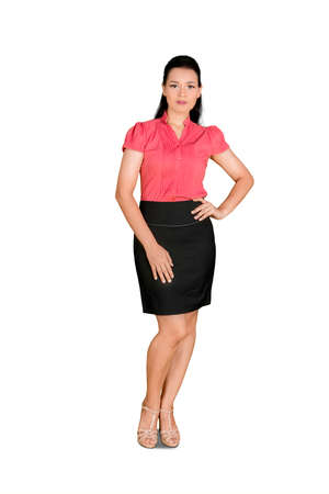 Photo pour Full length of business woman standing and posing with arms on her waist in the studio. Isolated on white background - image libre de droit