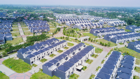 Photo pour JAKARTA - Indonesia. October 01, 2019: Aerial view of new residential houses surrounded by green garden - image libre de droit