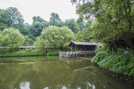 Landscape view of a traditional building in a garden