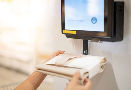 Photo for Female hand holding goods scanning barcode on information machine for check the price and information of the goods. Technology scanning barcode concept. - Royalty Free Image