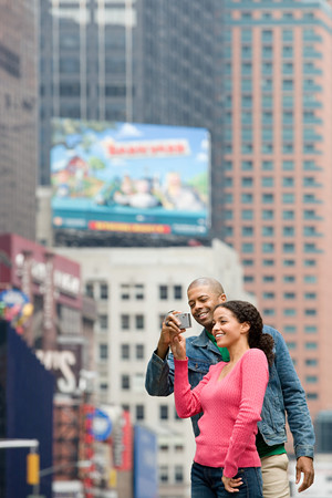Couple using digital camera