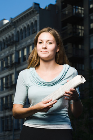 Woman holding newspaper
