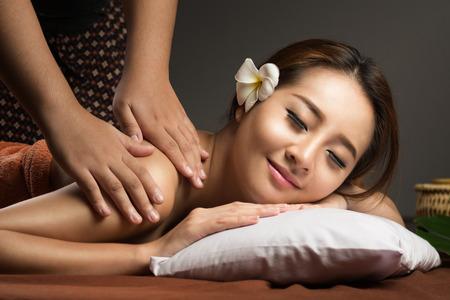 Photo pour Asian woman having massage and spa salon Beauty treatment concept. She is very relaxed - image libre de droit