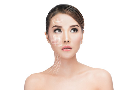 Photo pour Face lift anti-aging treatment, portraitAsian woman with graphic lines showing facial lifting effect on skin,antiaging concept. - image libre de droit