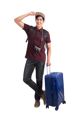 Foto de Traveler man. Young asian man with suitcase and camera isolated on white with Clipping path. - Imagen libre de derechos