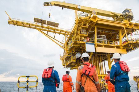 Photo pour workers on transport boat to offshore rig. industrial. energy. power oil and gas - image libre de droit