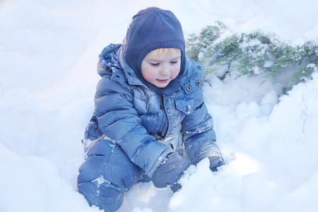 Foto de Snowing, laughing. Healthy childhood. Outdoors, copy space, close up portrait. - Imagen libre de derechos