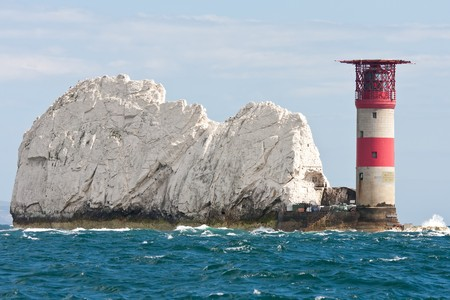 The lighthouse at the end of The Needles rocks on the Isle of Wight, Hampshire, UK.