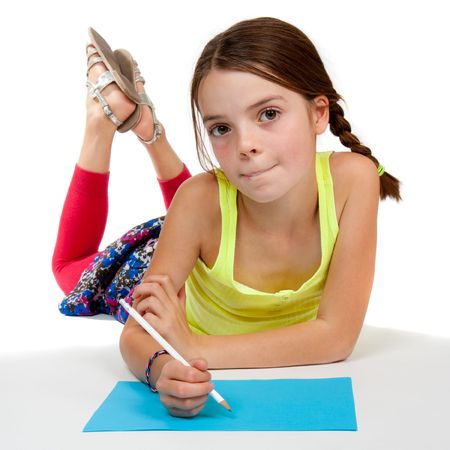 A primary aged girl looking thoughtful whilst drawing on some blue paper.