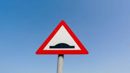 Photo pour Road sign speed humps on blue background - image libre de droit