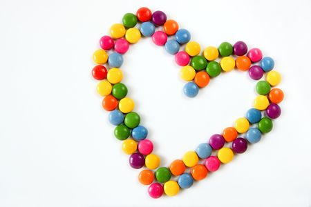Colorful hearts made from sweets isolated on a white background