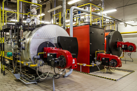 Photo pour Gas boilers in gas boiler room - image libre de droit