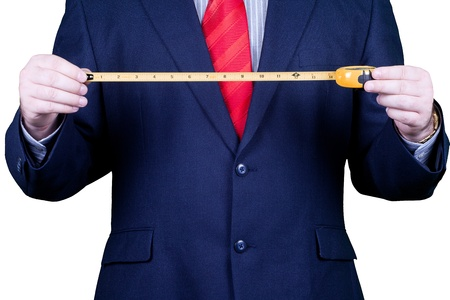 Businessman in suit and red tie measuring success.