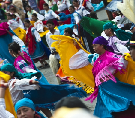 QUITO, DECEMBER 5, 2010: People in traditional Ecuadorean dresses dance as part of a parade through the streets celebrates its Spanish Foundation on December 5, 2010 in Quito, Ecuador