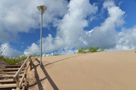dune at beach with wodden stairs