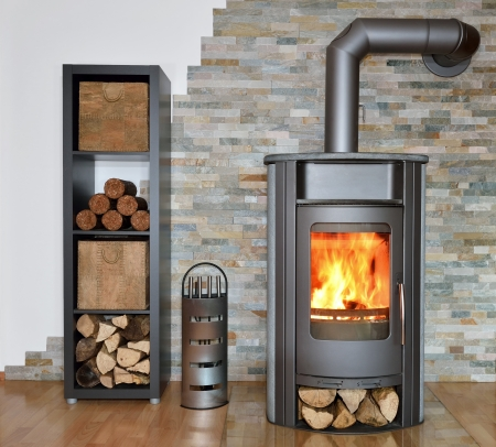 wood fired stove with fire-wood, fire-irons, and briquettes from bark