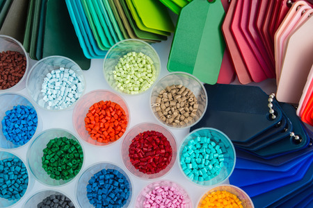Photo for several dyed plastic polymer granulates in laboratory - Royalty Free Image