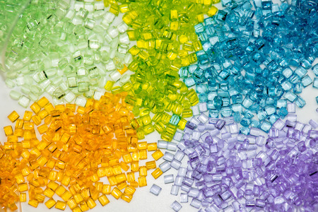 Photo for several different dyed polymer granulates in laboratory on table - Royalty Free Image