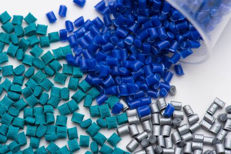 Photo for green glass-fibre reinforced, silver shiny non-reinforced and blue polymer plastic resin in lab - Royalty Free Image