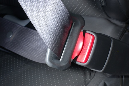Car seatbelt on the grey background