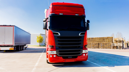Photo for Truck logistics building. the red truck on the road - Royalty Free Image