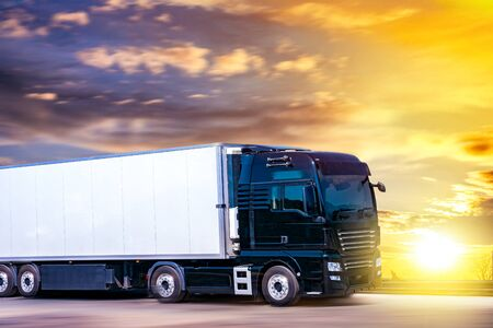 Truck moves on the road at speed, delivery of goods. Transport in Europe