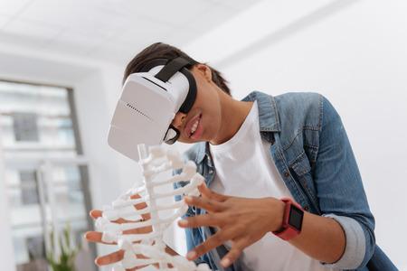 Foto de Joyful curious woman using 3d technology - Imagen libre de derechos