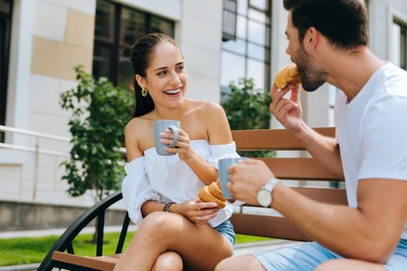 Positive happy woman looking at her boyfriend while being together with him