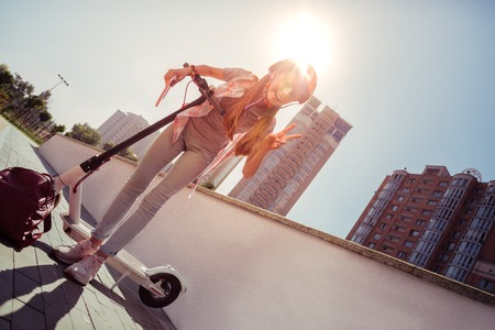Photo pour Amazing female person wearing helmet while going to cycling in park - image libre de droit