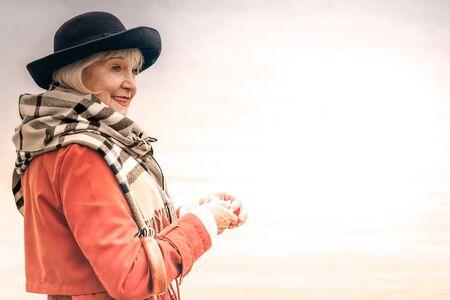 Photo pour Portrait of a smiling senior woman on the walk on a fine day - image libre de droit