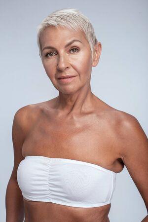 Foto de Beautiful middle aged woman posing in bra - Imagen libre de derechos