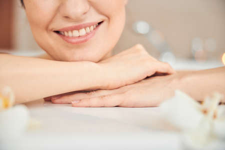 Photo for Cropped photo of Caucasian lady with the perfect skin smiling while relaxing alone - Royalty Free Image