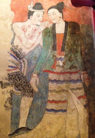 Mural of whispering man and woman, Nan province, Thailand