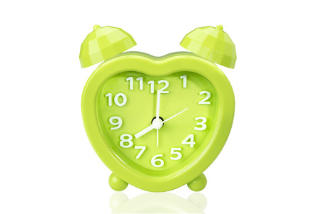 green alarm clock on white isolated background