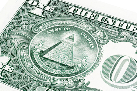 Stack of all seeing eye from a 1 dollar bill isolated on white
