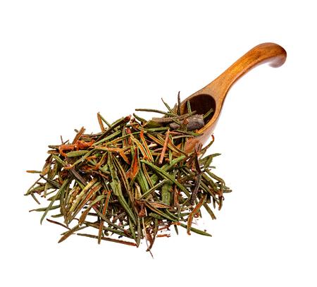 Marsh (Northern) Labrador Tea (Ledum palustre) on the wooden spoon.