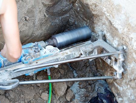 Photo pour Diamond drilling in concrete. Close-up photo. - image libre de droit