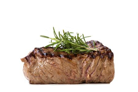 Nice juicy flamegrilled Filet Mignon isolated on white