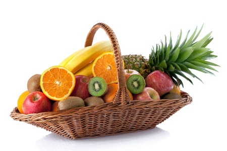 Photo for Fresh fruit in the basket against a white background - Royalty Free Image
