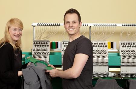 Photo pour Portrait of a shop assistant and a Young Man in her Textile embroidery Shop - image libre de droit