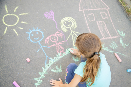 Photo for Child draws a family on the pavement with chalk. Selective focus. nature. - Royalty Free Image