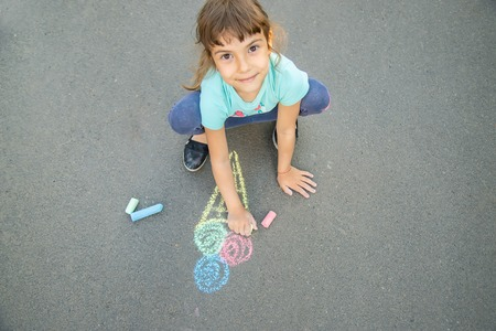 Photo for Child draws ice cream on asphalt with chalk. Selective focus. nature. - Royalty Free Image