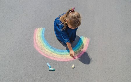 Photo for child draws with chalk on the pavement. Selective focus. - Royalty Free Image