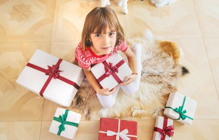 Photo for Children near the Christmas tree. Selective focus. - Royalty Free Image