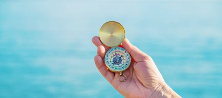 Photo for A man with a compass in his hands near the sea. Selective focus. nature. - Royalty Free Image
