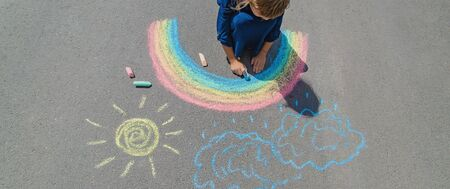 Photo for child draws with chalk on the pavement. Selective focus. nature. - Royalty Free Image