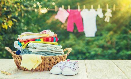 Photo pour washing baby clothes. Linen dries in the fresh air. Selective focus. nature. - image libre de droit