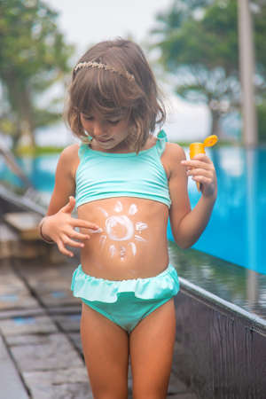Photo for Child on the beach with sunscreen on his back. Selective focus. - Royalty Free Image
